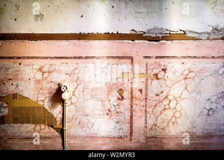 Close up of a stucco old wall with an electrical plug. Mahon, Baleares, Spain, Europe. - Stock Photo