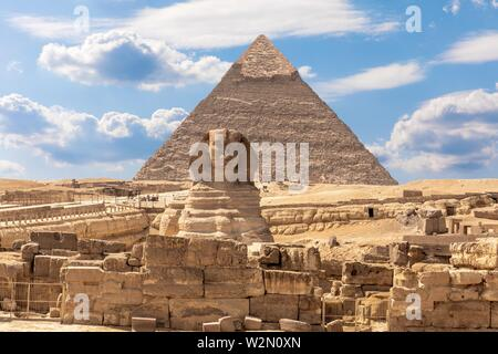 The Sphinx, the Pyramid of Chephren and the ruins of a temple in Giza, Egypt. - Stock Photo