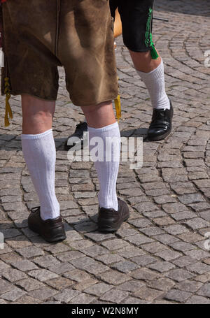Men at the Oktoberfest in traditional clothes, Lederhose, Munich - Stock Photo