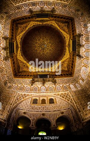 Ornate ceiling, The Alcázar of Seville (Real Alcazar) is a royal palace in Seville, Spain, built for the Christian king Peter of Castile. - Stock Photo