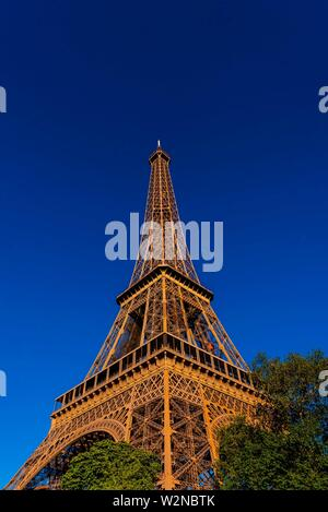 A low angle view of the Eiffel Tower, the world famous wrought-iron lattice tower that is the most famous landmark of Paris, France. - Stock Photo