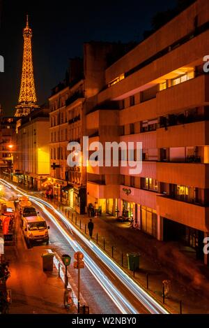 Blurred traffic on rue St. Dominque with the Eiffel Tower behind, Paris, France. It is the world famous wrought-iron lattice tower that is the most - Stock Photo
