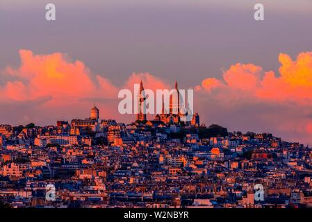 Sacre Coeur Basilica sits atop Montmatre, a large hill (butte) in northern Paris, France. - Stock Photo