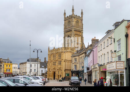 Street view of St John Baptist church and Circencester town centre, a market town called the Capital of the Cotswolds, in east Gloucestershire, UK - Stock Photo