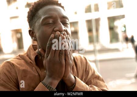 worried African man, in Frankfurt, Germany. - Stock Photo