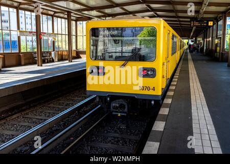 Berlin, Germany. U-Bahn / S-Bahn Train on Nollendorf Platz Station's Platform, picking up new passengers. - Stock Photo