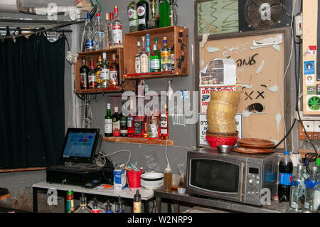 various bottles of alcohol on display in a bar. Photographed in Florentine Neighbourhood Tel Aviv, Israel - Stock Photo