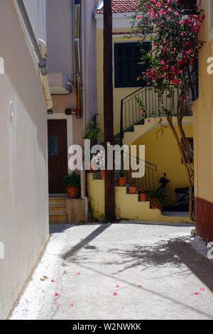 Corfu.small courtyard scene in the hillside village of Avliotes.showing the entrance to a house - Stock Photo