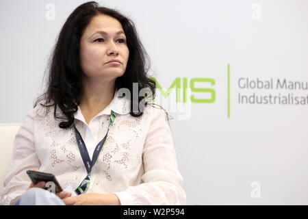 Yekaterinburg, Russia. 10th July, 2019. YEKATERINBURG, RUSSIA - JULY 10, 2019: Svetlana Erkenova, National Expert at the UNIDO Centre for International Industrial Cooperation (CIIC) in Moscow, during a panel discussion titled 'The Future of Business Compliance in Industry 4.0' as part of the 2019 Global Manufacturing and Industrialisation Summit (GMIS-2019) at the Ekaterinburg-EXPO International Exhibition Center. Yelena Afonina/TASS Host Photo Agency Credit: ITAR-TASS News Agency/Alamy Live News - Stock Photo