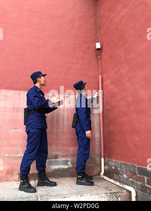 Beijing, China. 10th July, 2019. Photo taken with a mobile phone shows fire fighters examining lightening rod in the Palace Museum in Beijing, capital of China, July 10, 2019. Credit: Wu Wenxu/Xinhua/Alamy Live News - Stock Photo