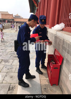 Beijing, China. 10th July, 2019. Photo taken with a mobile phone shows fire fighters examining fire extinguisher in the Palace Museum in Beijing, capital of China, July 10, 2019. Credit: Wu Wenxu/Xinhua/Alamy Live News - Stock Photo