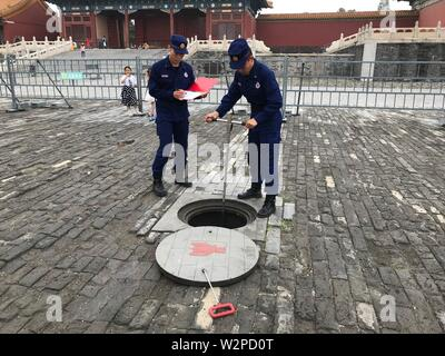 Beijing, China. 10th July, 2019. Photo taken with a mobile phone shows fire fighters examining fire hydrant in the Palace Museum in Beijing, capital of China, July 10, 2019. Credit: Wu Wenxu/Xinhua/Alamy Live News - Stock Photo
