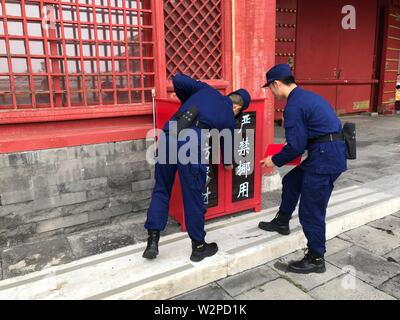Beijing, China. 10th July, 2019. Photo taken with a mobile phone shows fire fighters examining fire fighting equipments in the Palace Museum in Beijing, capital of China, July 10, 2019. Credit: Wu Wenxu/Xinhua/Alamy Live News - Stock Photo