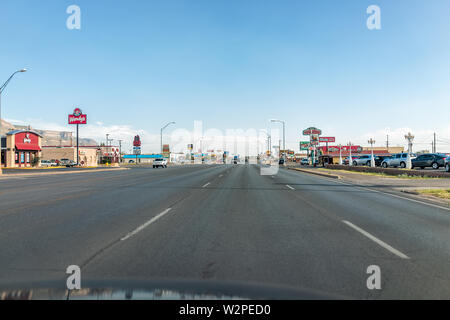 Alamogordo, USA - June 9, 2019: New Mexico city with S White Sands Boulevard with many fast food chain restaurants and wide road street - Stock Photo