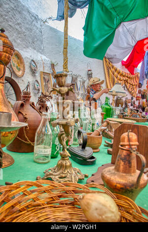 Mertola, Portugal - May 18, 2019: Seller of antiquities at the Islamic festival held in the streets of Mertola, Portugal - Stock Photo