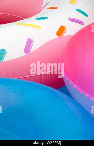 colors of the pool - inflatable colorful toy wheels - Stock Photo
