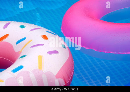 pool - closeup of fragments of two inflatable circles on the water surface - Stock Photo