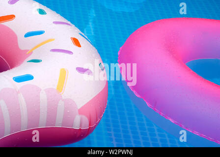 two inflatable wheels in the pool - two pool wheels on the water - Stock Photo