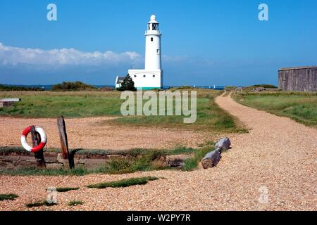 Hurst Point lighthouse guides boats into the solent - Stock Photo