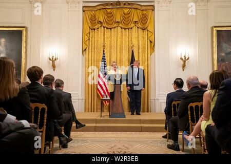 U.S President Donald Trump listens as Jackson County Commissioner Colleen Roberts, delivers remarks in support of forest management at the East Room of the White House July 8, 2019 in Washington, DC. - Stock Photo