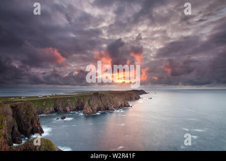 Spectacular sunset clouds over Tory Island in Donegal county - the most remote inhabited island of Ireland. - Stock Photo