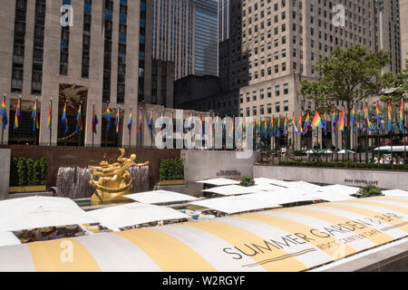 Rainbow color flags celebrate WorldPride at Rockefeller Center Plaza, NYC, USA - Stock Photo
