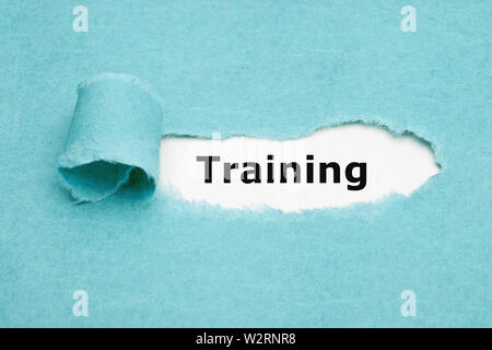 Printed word Training appearing behind ripped blue paper. Concept about learning and practising new skills of a particular job. - Stock Photo