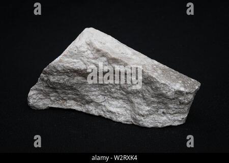 Grey and white gemstone gem jewel mineral precious stone piece - Stock Photo
