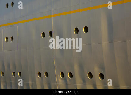 port of rotterdam, zuid holland/netherlands - july 22, 2014:   the weathered grey hull of the historic passenger vessel ss rotterdam with  a yellow st - Stock Photo