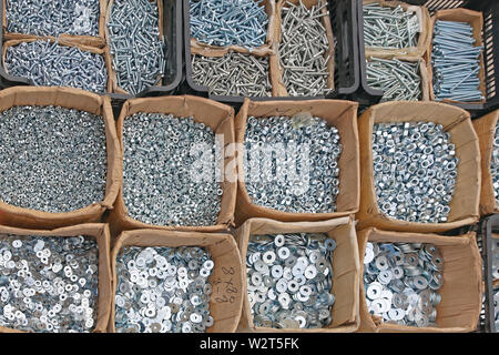Various Washers Nuts and Bolts in Boxes Parts - Stock Photo