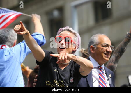 NEW YORK, NEW YORK - JULY 10: Megan Rapinoe acknowledges fans who turned out for the U.S. women's soccer team is celebrated with a parade.
