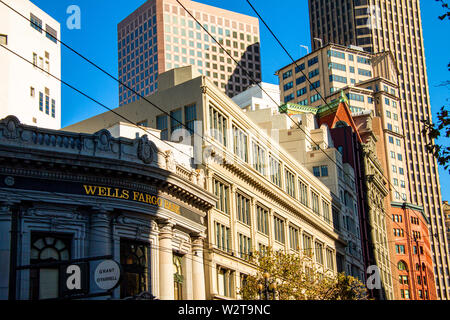 Image of old and new houses and structures in San Francisco showing the opposition between old historic brick building and modern glass highrise offic - Stock Photo