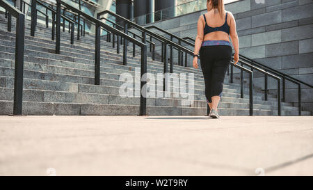 Going home  Back view of plus size woman in sport clothes