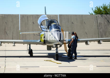 Boboc, Romania - May 22, 2019: Mechanics attend IAR 99 Soim (Hawk) advanced trainer and light attack airplane, used as jet trainer of the Romanian Air - Stock Photo