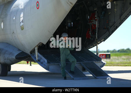Boboc, Romania - May 22, 2019: A military mechanic is standing in an Alenia C-27J Spartan military cargo plane from the Bulgarian Air Force that lande - Stock Photo
