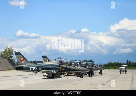 Boboc, Romania - May 22, 2019: Mechanics attend IAR 99 Soim (Hawk) advanced trainer and light attack airplanes, used as jet trainer of the Romanian Ai - Stock Photo