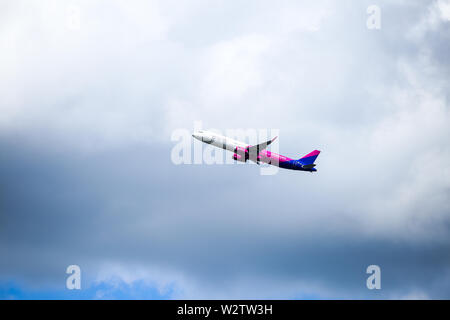 Otopeni, Romania - May 22, 2019: A Wizzair commercial airplane is taking off from the Henri Coanda International Airport. - Stock Photo