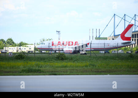 Otopeni, Romania - May 22, 2019: A Lauda commercial airplane is taking off from the Henri Coanda International Airport. - Stock Photo