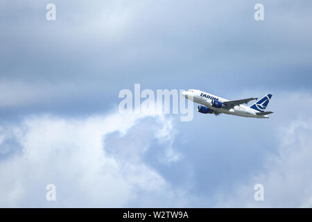 Otopeni, Romania - May 22, 2019: A TAROM commercial airplane is taking off from the Henri Coanda International Airport. - Stock Photo