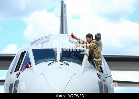 Otopeni, Romania - May 22, 2019: A military pilot of an Alenia C-27J Spartan military cargo plane from the Italian Air Force is cleaning the windscree - Stock Photo