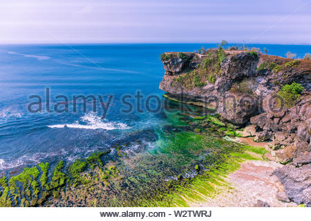 Aerial view of cliffs at Balangan beach in the Kuta area of Bali, Indonesia - Stock Photo