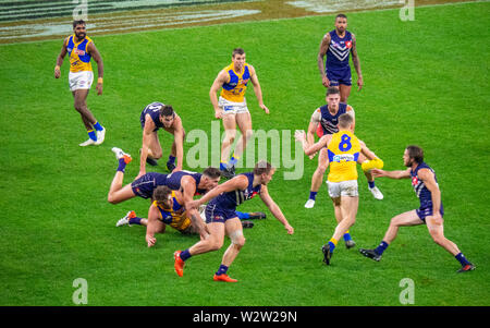 West Coast Eagles and Fremantle Dockers football players in Western Derby AFL game at Optus Stadium Perth Western Australia. - Stock Photo