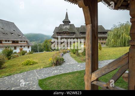 Characteristic architecture of the Maramures region of Romania as seen at Barsana Monastery. - Stock Photo