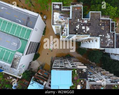 Beijing, China. 10th July, 2019. Aerial photo taken on July 10, 2019 shows medical workers rescuing people in Liuzhou City, south China's Guangxi Zhuang Autonomous Region. Credit: Lu Xianting/Xinhua/Alamy Live News - Stock Photo