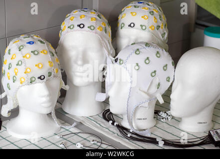 Magdeburg, Germany. 03rd May, 2019. Head hoods with electrodes for measuring brain currents can be seen in the Laboratory of Neurobiology at the Leibniz Institute. Developmental psychologist Wetzel heads the CBBS Neurocognitive Development research group and, together with her team, investigates attention in childhood and in adults as well as the effects of distraction in thought and learning processes. (to dpa story 'Technology and Brain') Credit: Jens Büttner/dpa-Zentralbild/dpa/Alamy Live News - Stock Photo