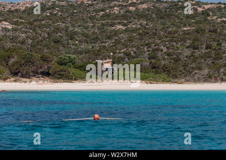 Amazing azure sea water on pink beach maddalena budelli island in Sardinia , Italy - Stock Photo