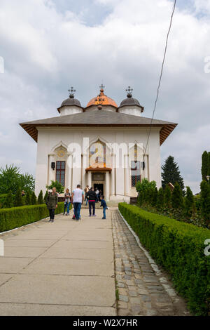 Ilfov, near Bucharest, Romania - April 30, 2019: People visiting orthodox Cernica Monastery.