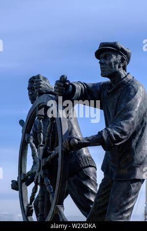 Man and Boy Seafaring Statue at Brixham Harbour Brixham Devon England - Stock Photo