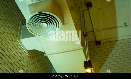 Air duct on ceiling. Air conditioner pipe system. Air ventilation system. Air heading unit on wall. Cool system in building. Building interior. - Stock Photo