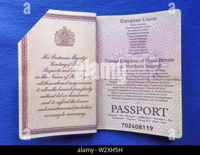 Expired British EU passport with corner cut - Stock Photo
